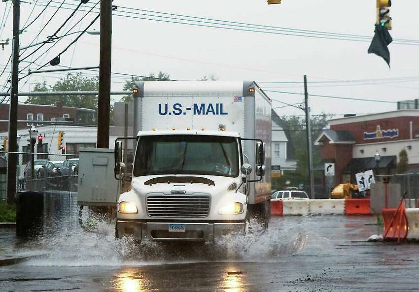 A mail truck heads down Jefferson Street as high winds and rain hit Stamford, Conn. on Friday October 1, 2010.