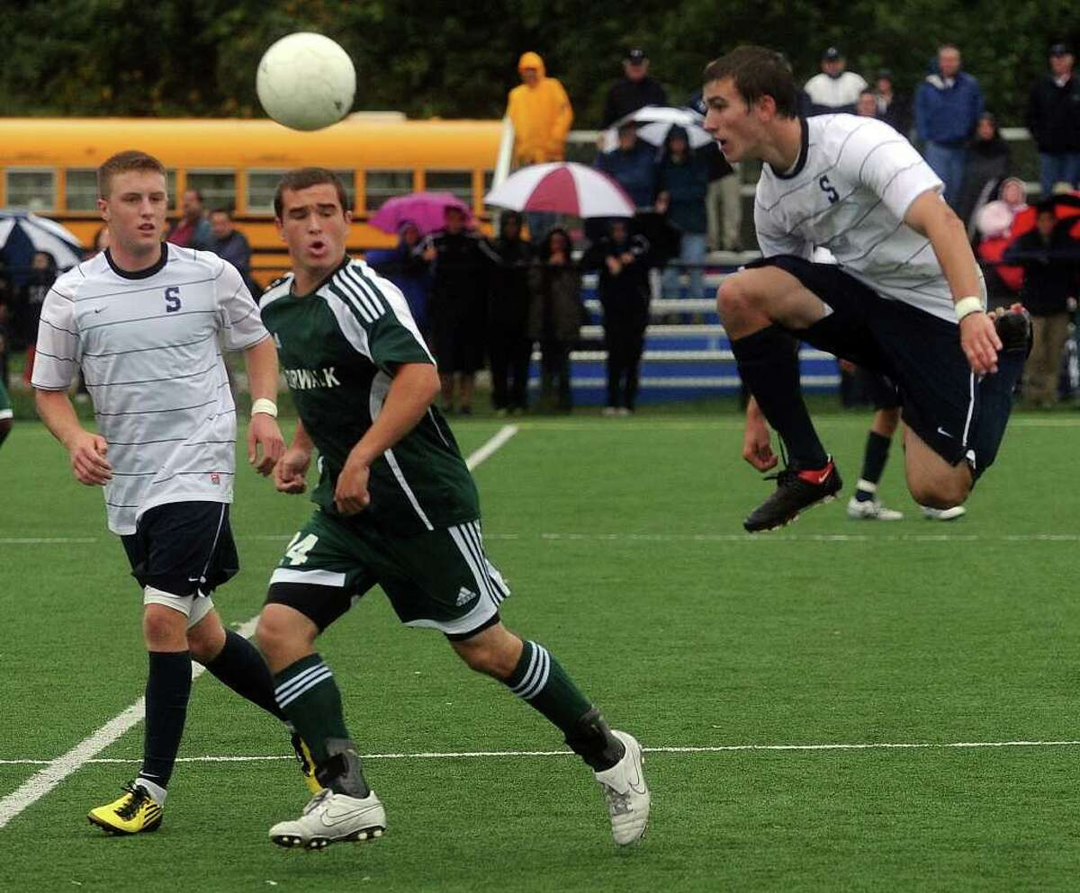 From left, Staples' Brendan Lesch, Norwalk's Spencer Jacoby, and Staples' Sean Gallagher compete during Friday's game in Westport on October 1, 2010.