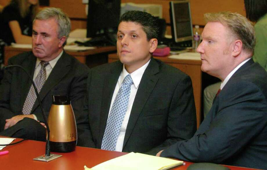 Lawyer Mickey Sherman, left, defendant Marash Gojcaj, center and lawyer Stephan Seeger are shown during jury selection. Photo: Chris Ware / The News-Times