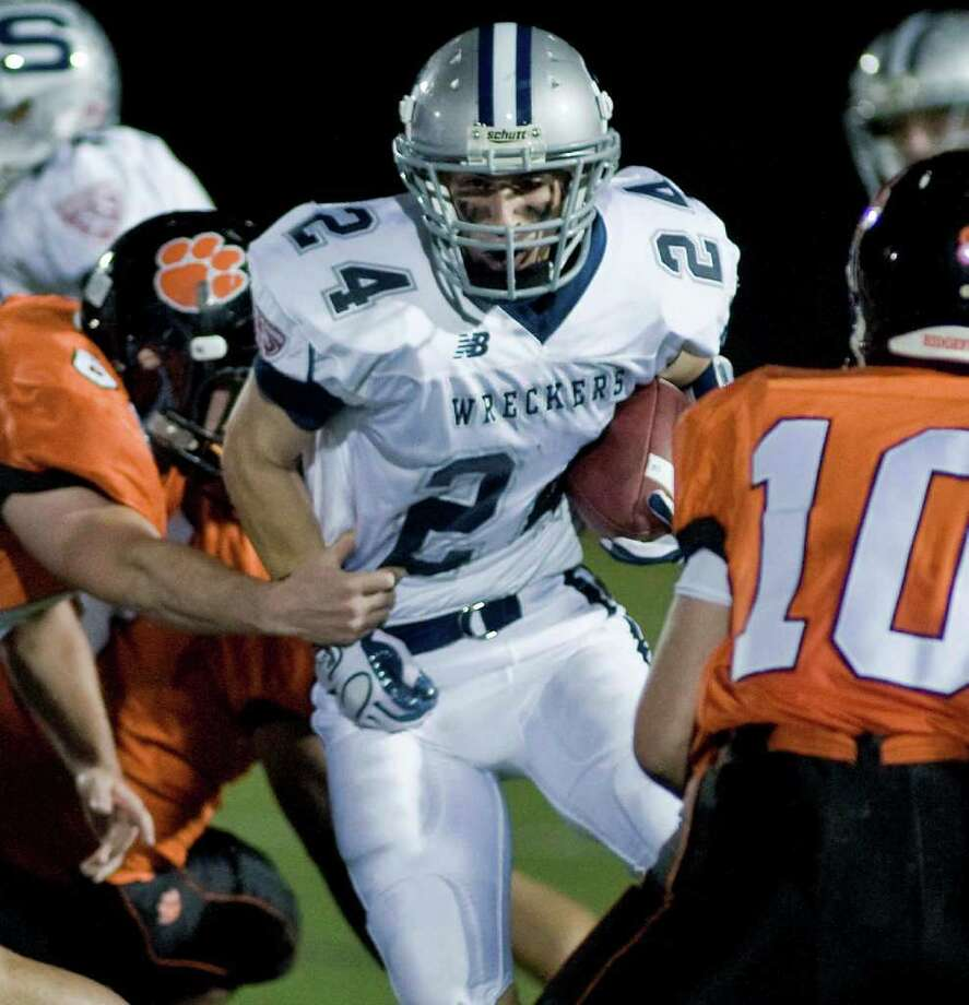 Tyler Jacobs of Staples running the ball during a football game against Ridgefield, at Ridgefield. Friday, Oct. 1, 2010 Photo: Scott Mullin / The News-Times Freelance