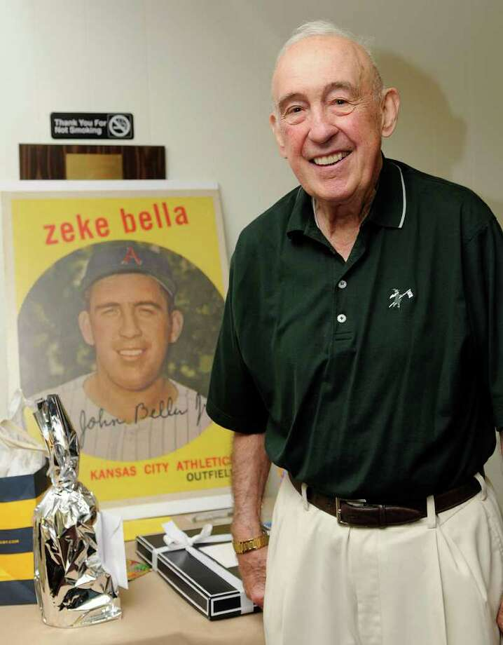 "Cos Cob's John ""Zeke"" Bella, former outfielder for the New York Yankees and Kansas City Athletics, stands in front of a replica of his baseball card during his 80th birthday party with friends and family at the St. Lawrence Club in Cos Cob in August. Photo: File Photo / Greenwich Time File Photo"