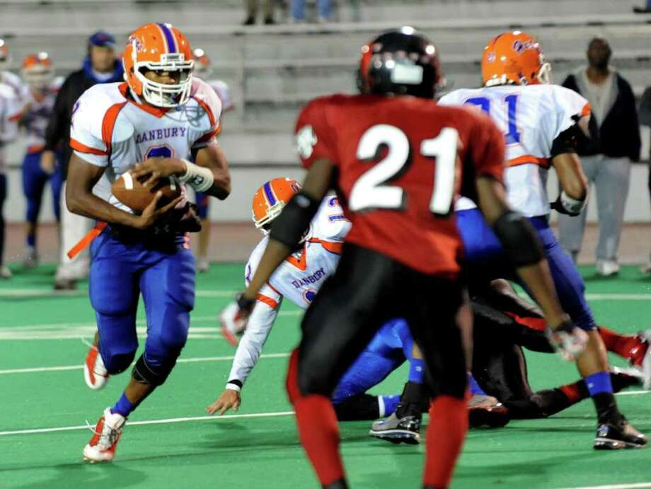 Football action between Central High and Danbury High at Central's Kennedy Stadium in Bridgeport, Conn. on Friday October 1, 2010. Danbury's #2 Aaron Dixon. Photo: Christian Abraham / Connecticut Post