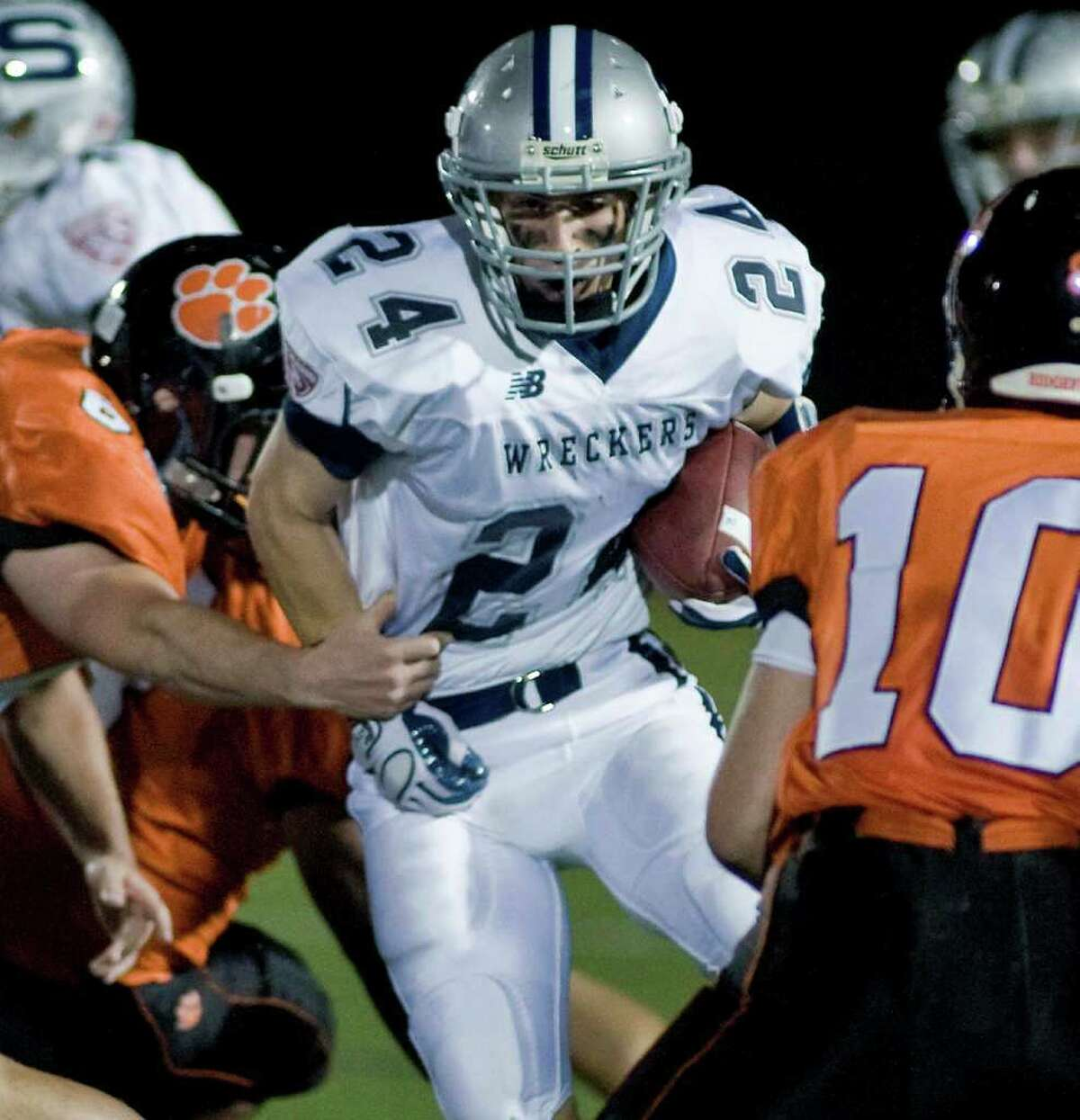 Tyler Jacobs of Staples running the ball during a football game against Ridgefield, at Ridgefield. Friday, Oct. 1, 2010