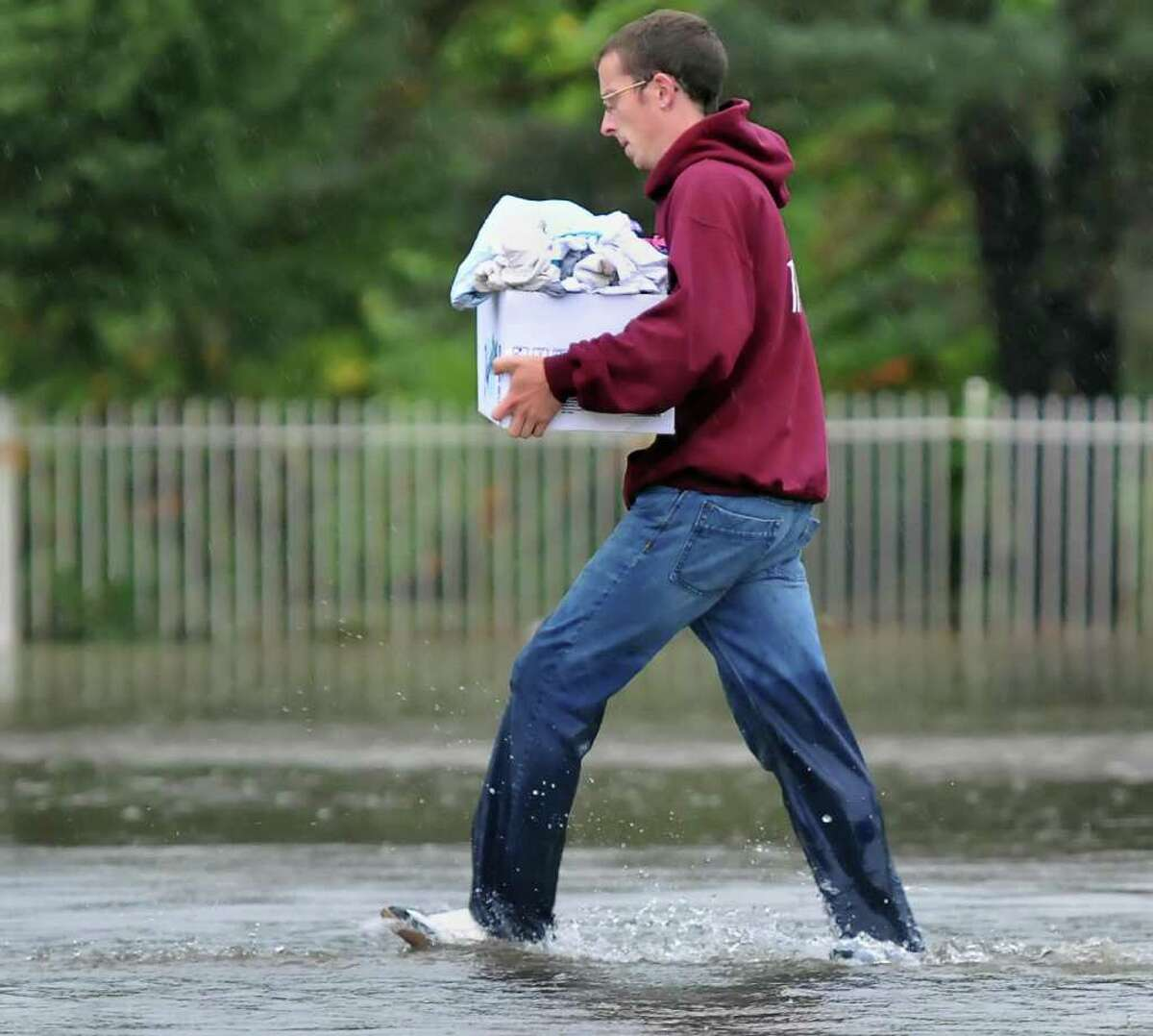 A Sumpter Street resident retrieves belongings from his flooded home in West Albany in 2010. (John Carl D'Annibale / Times Union)