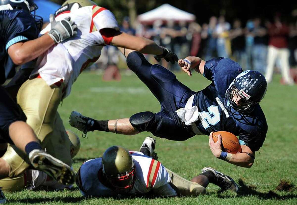 Oxford's Nick Donofrio throws himself over a fallen Stratford player during their game Saturday Oct. 2, 2010 at Oxford High School.