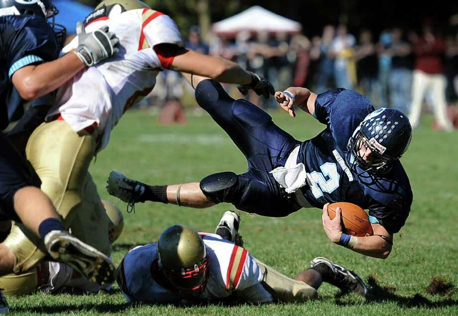 Oxford's Nick Donofrio throws himself over a fallen Stratford player during their game Saturday Oct. 2, 2010 at Oxford High School. Photo: Autumn Driscoll / Connecticut Post