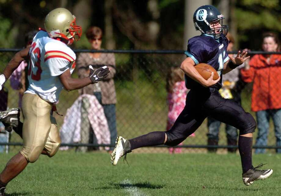 Oxford's Alex Miller stays ahead of Stratford's Lawrence Butler on his way to a touchdown after catching a fumble during their game Saturday Oct. 2, 2010 at Oxford High School. Photo: Autumn Driscoll / Connecticut Post