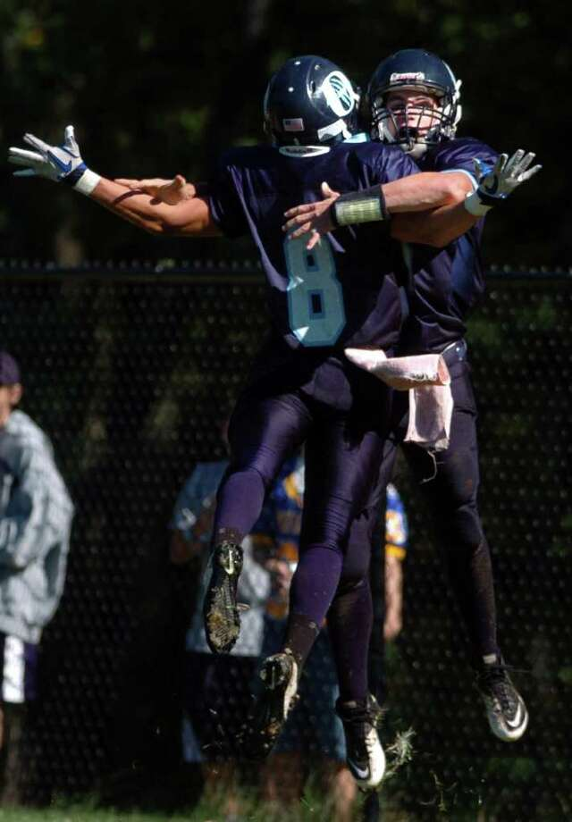 Oxford's Alex Miller and Justin Lasto (8) celebrate a touchdown during their game against Stratford Saturday Oct. 2, 2010 at Oxford High School. Photo: Autumn Driscoll / Connecticut Post
