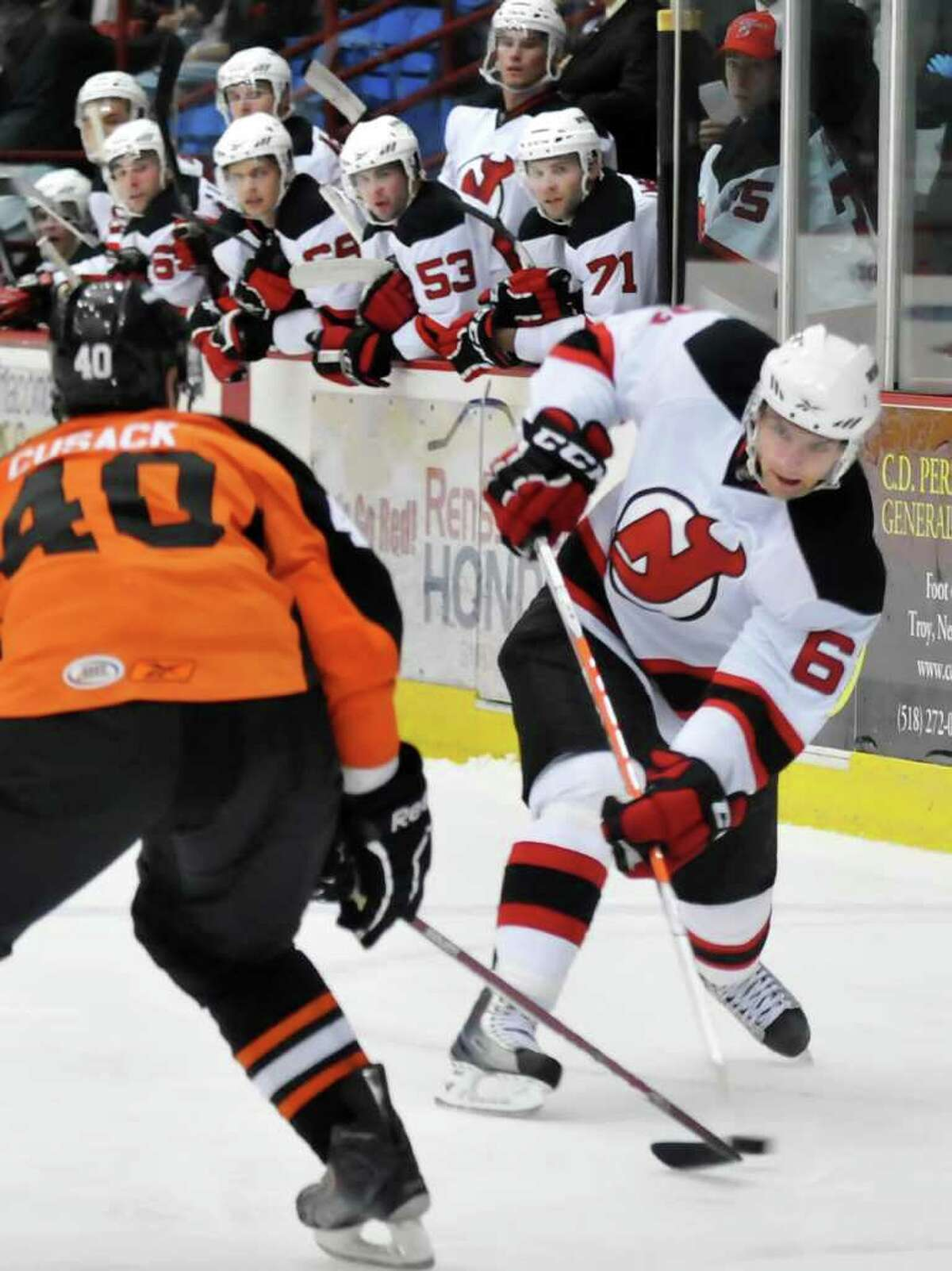 Darcy Zajac takes a shot on goal for the Albany Devils during their 4-2 victory over the Adirondack Phantoms on Saturday night in an American Hockey League exhibition game played at Houston Field House on the Rensselaer Polytechnic Institute campus in Troy. Adirondack's Patrick Cusack, left, defends. (John Carl D'Annibale / Times Union)