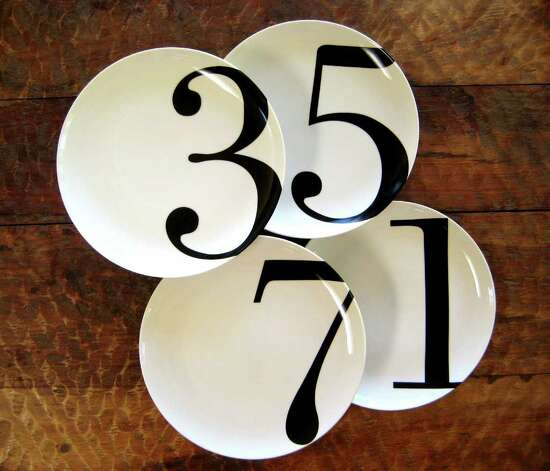 Christopher Jagmin makes odd- and even-numbered porcelain plate sets. Numbers and letters are hot off the press this season in decorative items, dishware and soft furnishings. (Christopher Jagmin / Associated Press)