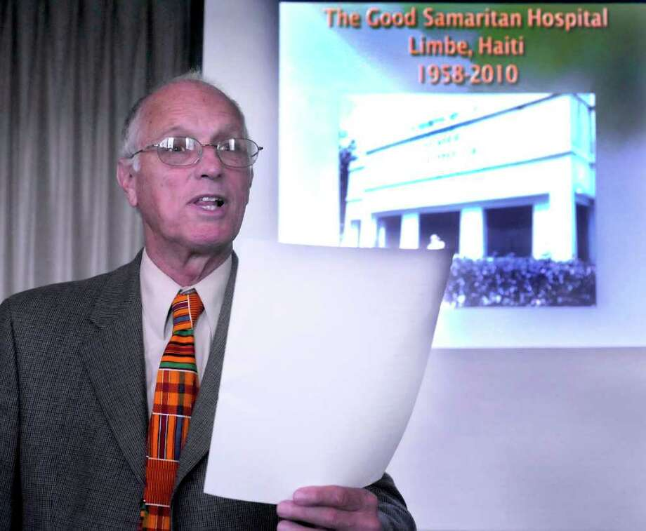 Dr. Jack Gundy, of Newtown, reads a poem he wrote while working in post-earthquake Hati. He described his expierences to the congregation at the First Congregational Church of Danbury, Sunday, Oct. 3, 2010. Photo: Michael Duffy / The News-Times