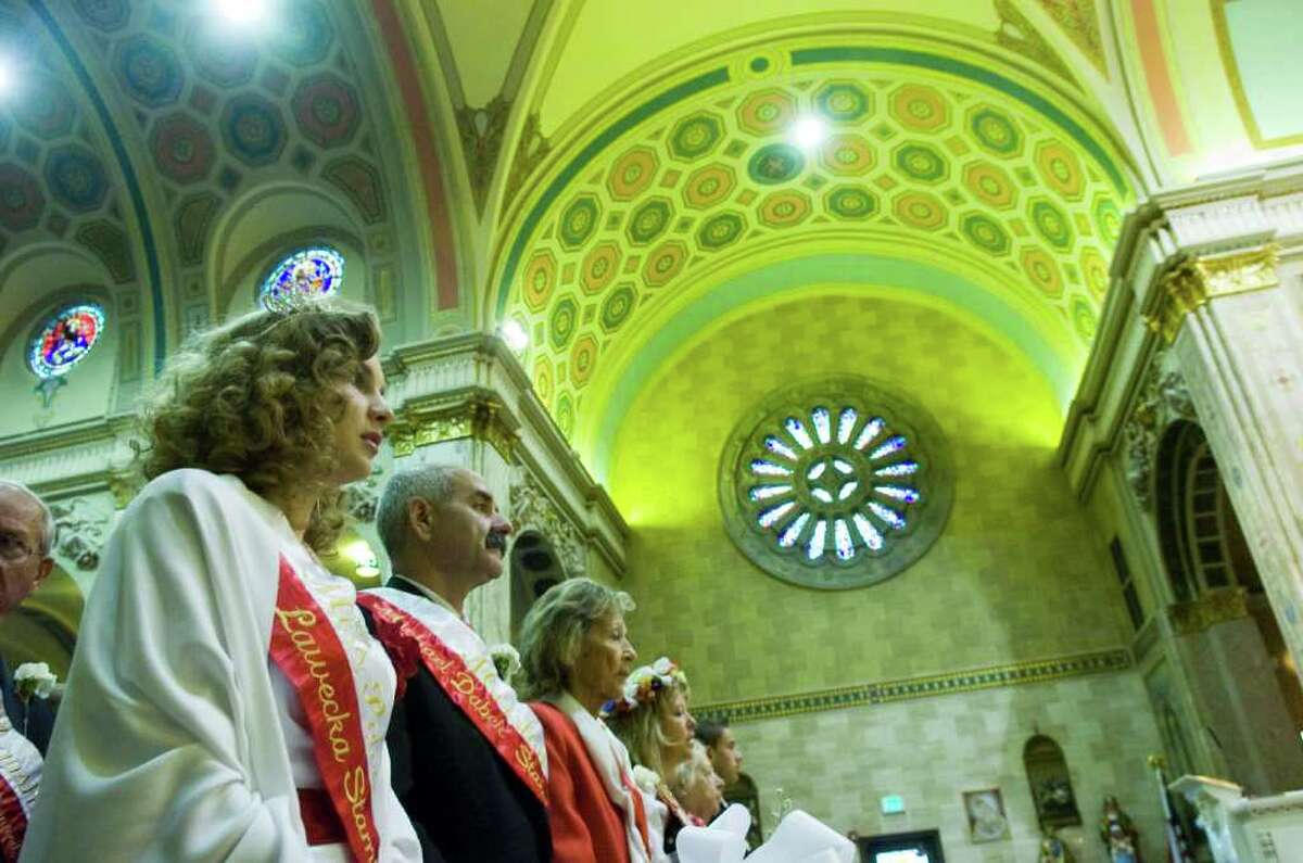 Miss Polonia Stamford Monika Lawecka, left, and Stamford's Grand Marshal Michael Dabek, center, join fellow congregants for Mass at Holy Name of Jesus Church Sunday October 3, 2010. Following Mass congregants headed to New York City to march in the 73rd Annual Pulaski Day Parade along Fifth Avenue. This is the 39th year the Stamford congregation has participated in the parade which commemorates Polish officer Casimir Pulaski. Pulaski helped train the US cavalry and soldiers during the American Revolution; he died on October 9, 1779 from wounds suffered during the Seige of Savannah, a failed attempt to wrestle control of the city from the British in 1779. In 2009 President Barack Obama signed a resolution making Pulaski an American citizen.