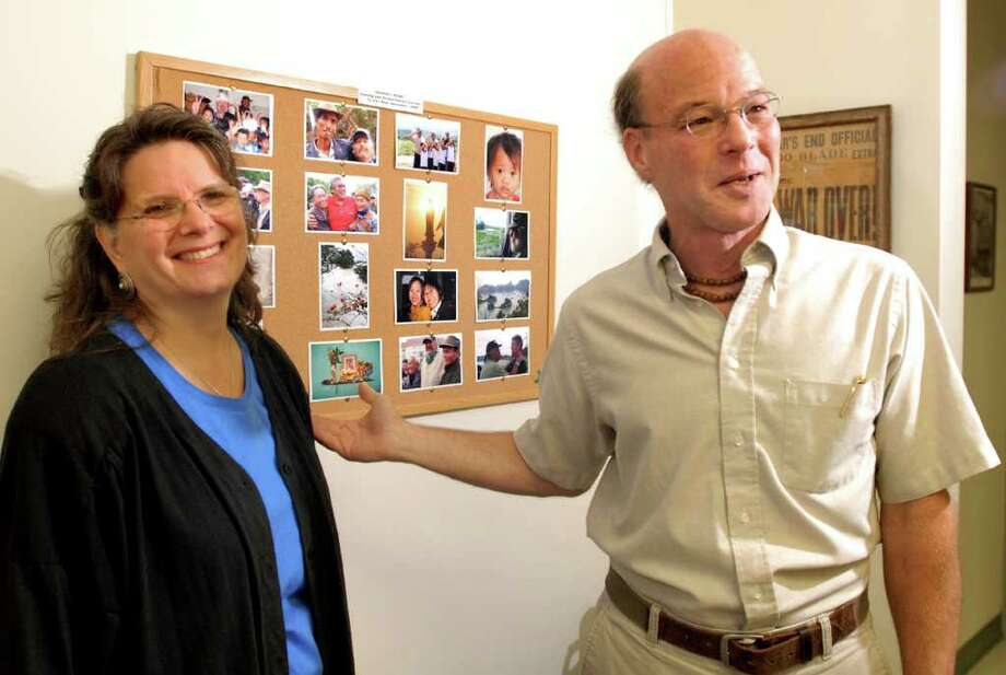 Ed Tick, right, and his wife Kate Dahlstedt talk about a recent trip trip to Vietnam on Tuesday, Sept. 14, 2010, at Soldier's Heart in Troy. Tick, who has helped Vietnam veterans heal their war wounds, is bringing a touring exhibit of Vietnamese art to the Capital Region in November at the Sage Colleges in Troy. (Cindy Schultz / Times Union) Photo: Cindy Schultz / 00010237A