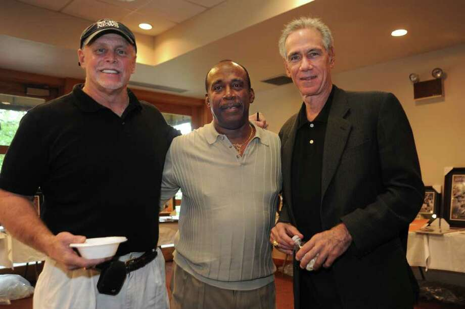 Three retired Jewish major league baseball players, Ron Blomberg, left, Elliott Maddox,and Art Shamsky, came together at Jewish Baseball Fest at Temple Sholom on Sunday, Oct. 3, 2010. Photo: Helen Neafsey / Greenwich Time