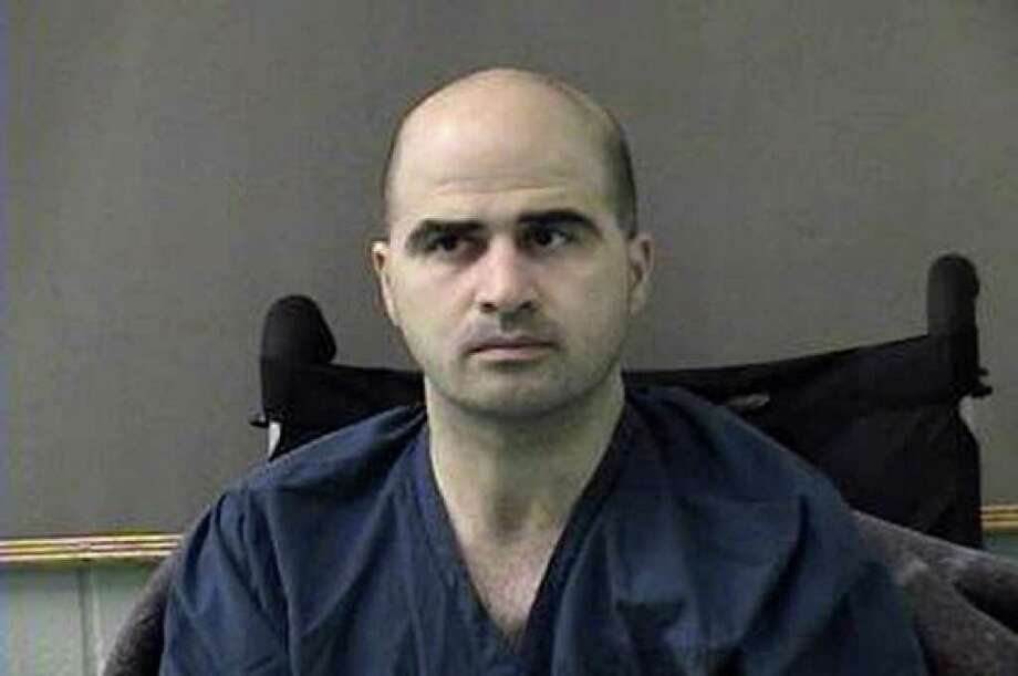 In a photo released by the Bell County Sheriff's Department, U.S. Army Maj. Nidal Malik Hasan is shown after being moved from Brooke Army Medical Center to Bell County Jail in Belton.