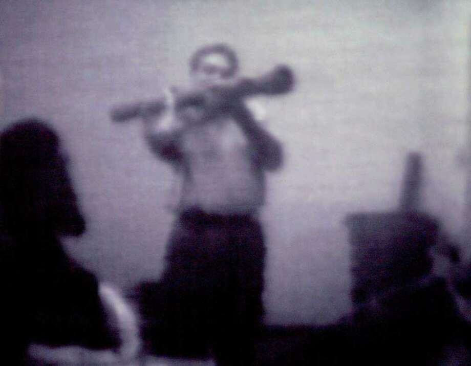 "Surveillance photo of Shahed ""Malik"" Hussain, an FBI informant, showing a rocket launcher to one of two Albany men convicted in a 2006 counterterrorism sting. Hussain's role as an informant is under scrutiny in the trial of four Newburgh men."
