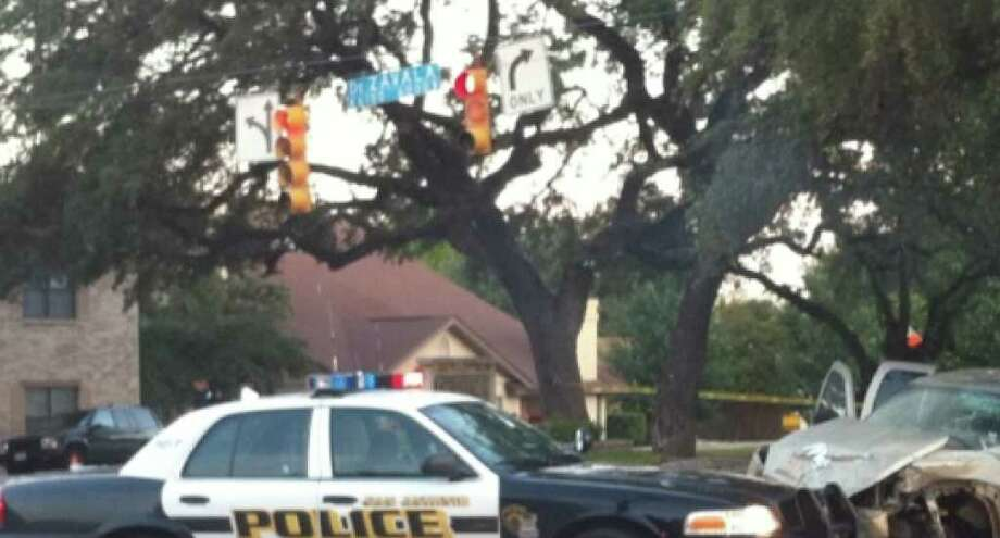 San Antonio police process a scene on the North Side, where two suspected burglars being chased by police crashed.