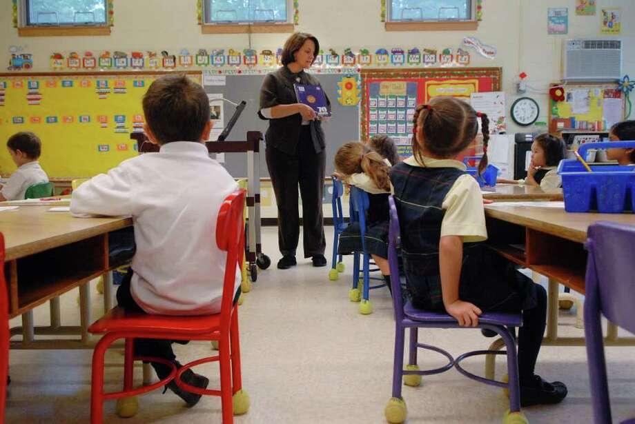 Kindergarten teacher Alicia Stenard works with her students Monday at Mater Christi School in Albany.   (Paul Buckowski / Times Union) Photo: Paul Buckowski / 00010509A