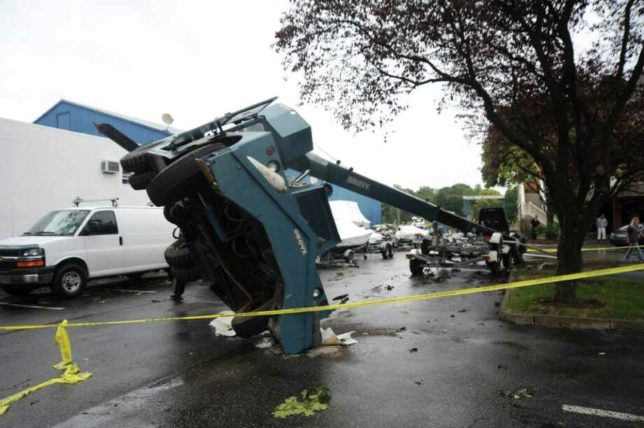 A crane fell over at Palmer Point Marina on Monday, Oct. 4, 2010. Photo: Helen Neafsey / Greenwich Time