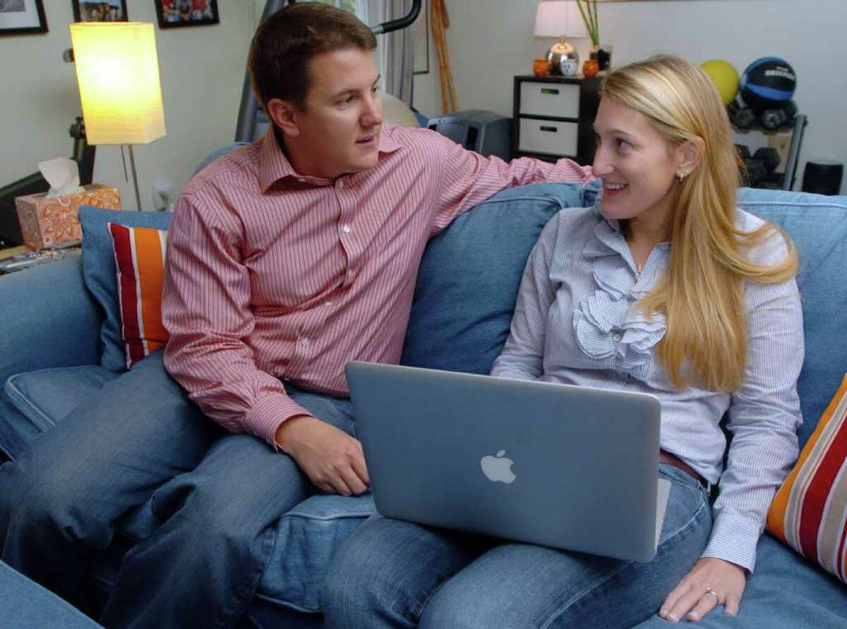 Matt and Bonnie Dewkett, The Joyful Organizer in Danbury, talk about a client at their home Oct., 4, 2010.