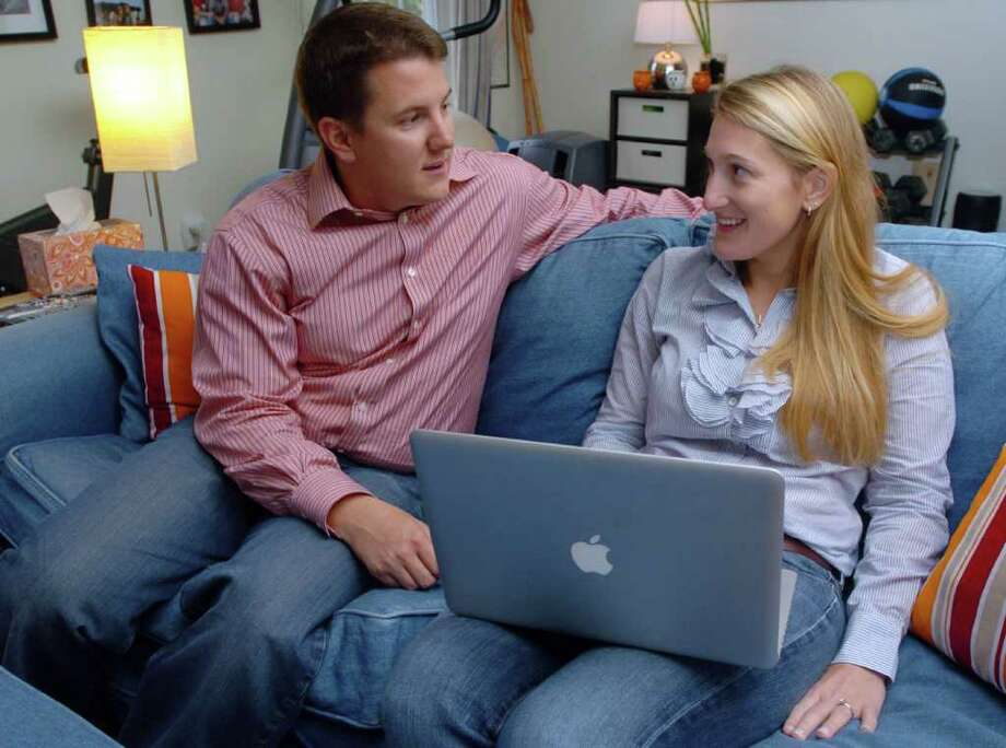 Matt and Bonnie Dewkett, The Joyful Organizer in Danbury, talk about a client at their home Oct., 4, 2010. Photo: Chris Ware / The News-Times