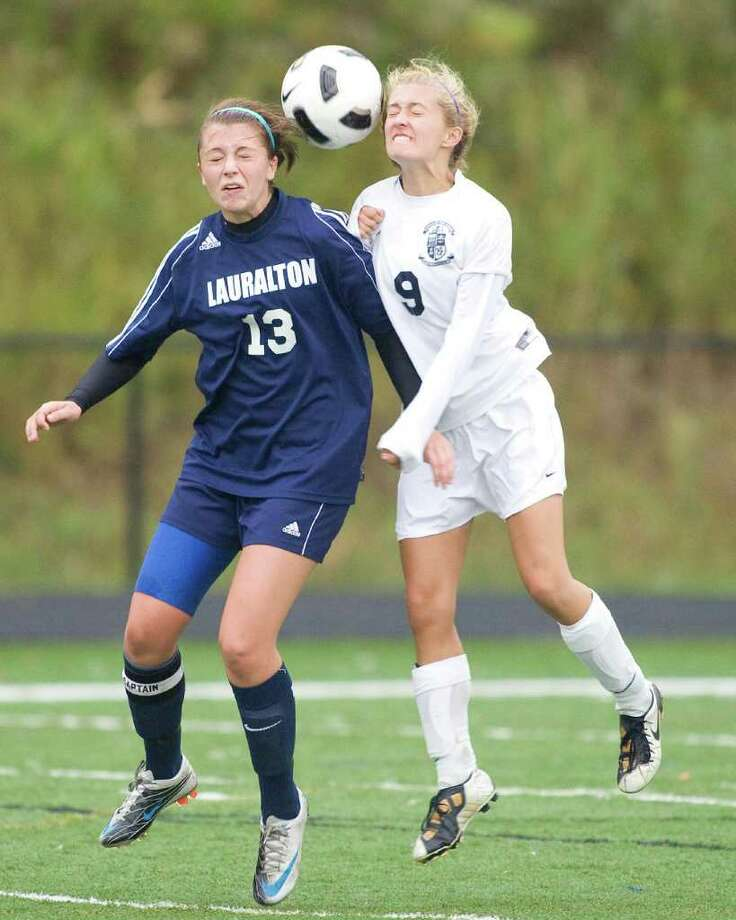Immaculate's Jaclyn Daily (9) and Lauralton Hall's Stephanie D'Andrea both try to get a head on the ball during Monday's match at Immaculate High. Photo: Barry Horn / The News-Times Freelance