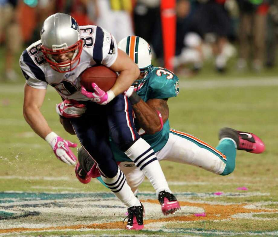 Miami Dolphins safety Yeremiah Bell (37) tackles New England Patriots wide receiver Wes Welker (83) during the third quarter of an NFL football game, Monday, Oct. 4, 2010, in Miami. (AP Photo/Steve Mitchell) Photo: AP