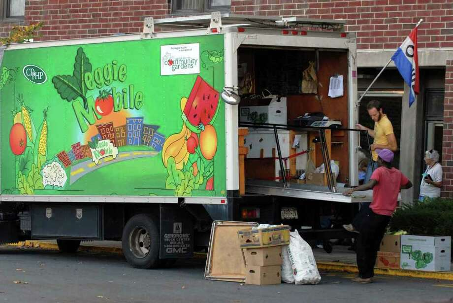 The Veggie Mobile sets up at the Cohoes Senior Center Wednesday, Sept 29, 2010. (Michael P. Farrell / Times Union) Photo: Michael P. Farrell / 00010443A