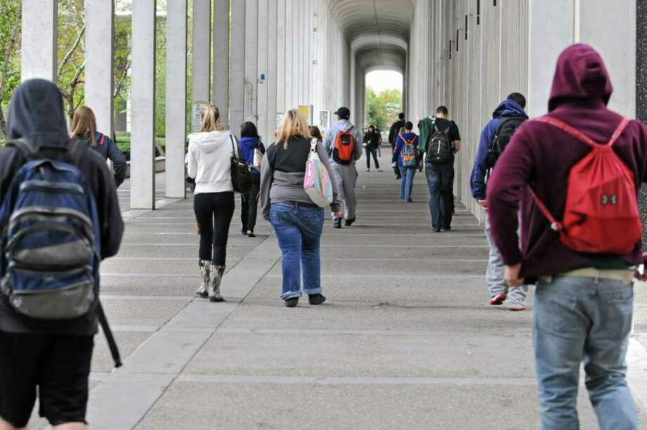 Students walk to class at UAlbany in Albany, NY on October 4, 2010. (Lori Van Buren / Times Union) Photo: Lori Van Buren
