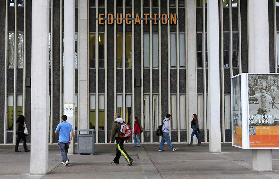 Students walk to class at UAlbany in Albany, NY on October 4, 2010. (Lori Van Buren / Times Union)