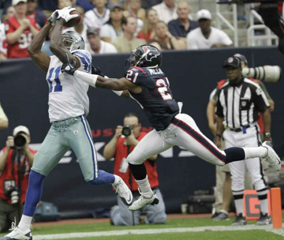 Dallas Cowboys wide receiver Roy Williams makes the catch for a touchdown despite the efforts of Houston Texans cornerback Brice McCain in the third quarter Sunday, Sept. 26 in Houston.