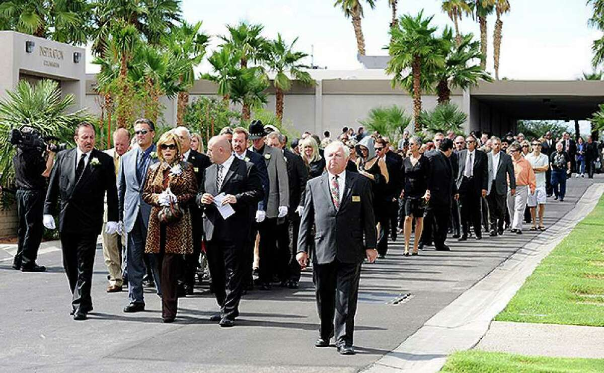 HENDERSON, NV - OCTOBER 04: Mourners walk to the burial site for Tony Curtis during the actor's funeral at Palm Mortuary & Cemetary October 4, 2010 in Henderson, Nevada. Curtis died on September 29 at age 85. (Photo by Ethan Miller/Getty Images)