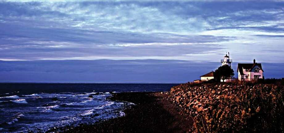 David Quesnette took this photograph of Stratford Point Lighthouse at sunrise in September 2008, after a heavy rain storm. Quesnette participates in the Fairfield Photographer's Network. Photo: Contributed Photo / Fairfield Citizen contributed