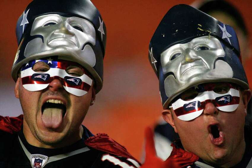 MIAMI - OCTOBER 04: New England Patriots fans cheer during warm up against the Miami Dolphins at Sun Life Stadium on October 4, 2010 in Miami, Florida. (Photo by Marc Serota/Getty Images)