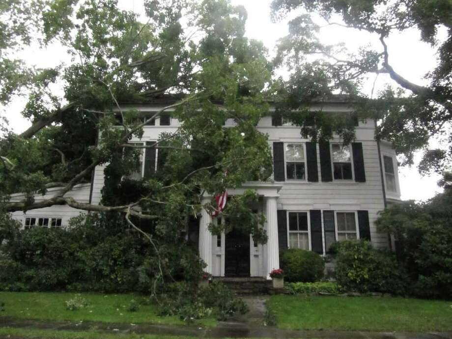 A large branch from a sugar maple tree fell on the home at 96 Willow Street Tuesday afternoon. The branch fell cable and telephone lines but the historic home, which dates back to 1797, did not suffer significant damage. Photo: Kirk Lang / Fairfield Citizen