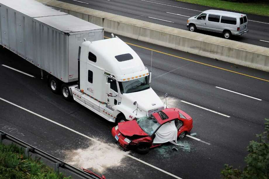 The accident scene where a tractor trailer broadsided a red Volkswagen between the Route 7 connector northbound on-ramp to I-95 and Exit 14 in Norwalk, Conn. on Tuesday October 5, 2010. Photo: Kathleen O'Rourke / Stamford Advocate