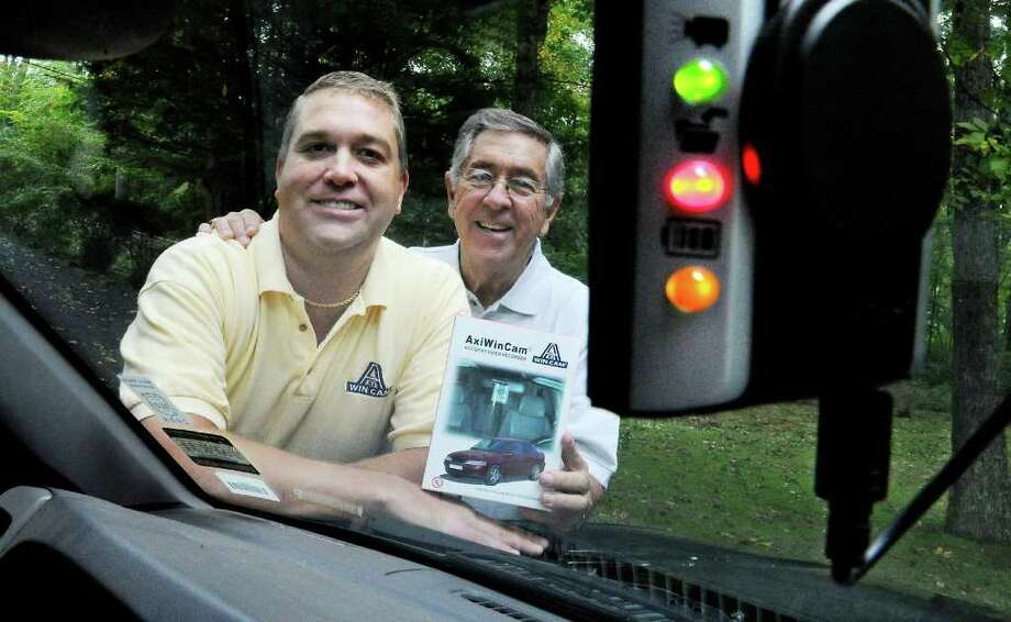 Christopher Gautrau and his father Dom Gautrau with their product, the AxiWinCam, an accident video recoreder, mounted in their car in Stamford, Conn. on Tuesday October 5, 2010. Photo: Kathleen O'Rourke / Stamford Advocate