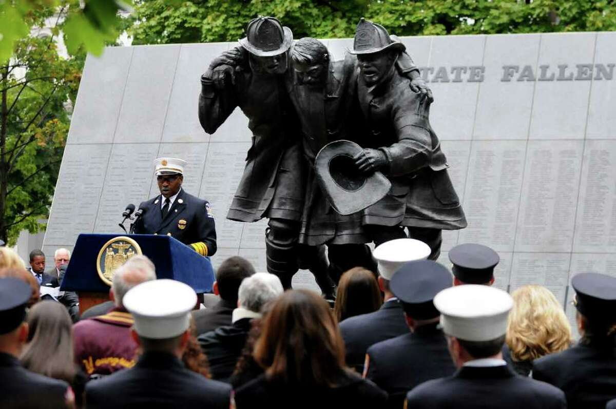 Floyd Madison, state Fire Administrator of the Office of Fire Prevention and Council, speaks during the Fallen Firefighters Memorial Ceremony on Tuesday, Oct. 5, 2010, at the Empire State Plaza in Albany. The ceremony honored nine firefighters who gave their lives in the line of duty. Of the firefighters added to the wall, seven died in 2009 and the other two are from previous years. There are now 2,357 names on the wall. (Cindy Schultz / Times Union) (Cindy Schultz / Times Union)