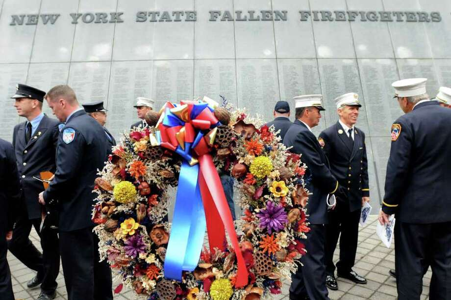 Firefighters gather at the Fallen Firefighters Memorial Ceremony on Tuesday, Oct. 5 at the Empire State Plaza in Albany. (Cindy Schultz / Times Union) Photo: Cindy Schultz