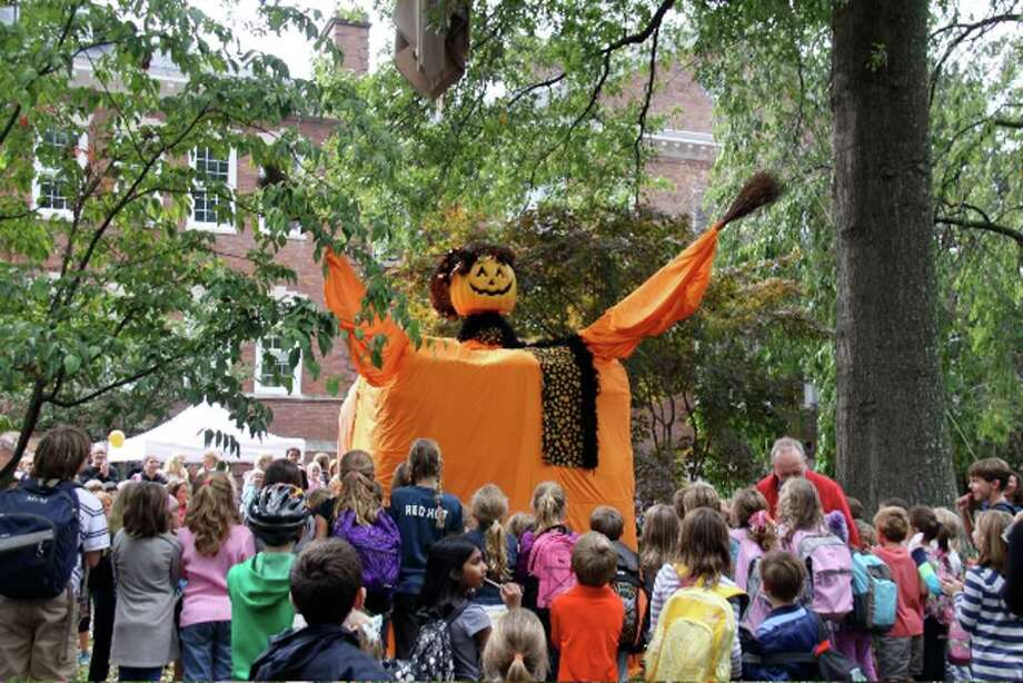"Old Greenwich School kicked off their annual ""Pumpkin Patch"" event with the unveiling of the amazing Pumpkin Lady. A much beloved tradition at OGS, this year the lady got her own costume, with eyes in the back of her head, just like all moms have. Pumpkin Patch will be held on Saturday, Oct. 16 from 11 a.m. until 4 p.m. at Old Greenwich School on Sound Beach Ave. The event offers fun for all ages including games, rides, pumpkins, food, music and, of course, a spooky house. Photo: Contributed Photo / Greenwich Citizen"