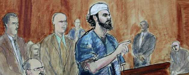 This courtroom sketch made Tuesday, Oct. 5, 2010 shows Faisal Shahzad, center, surrounded by U.S. Marshals and accompanied by his attorney Philip Weinstein, left, during his sentencing in Manhattan Federal court in New York. The Pakistani immigrant who tried to set off a car bomb in Times Square in May 2010 was sentenced Tuesday to life in prison. (AP Photo/Elizabeth Williams)