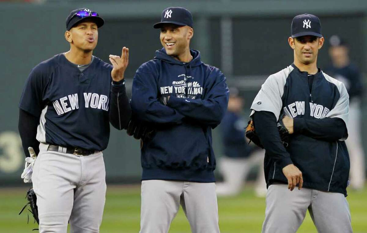 New York Yankees' Alex Rodriguez, left, Derek Jeter and Jorge Posada, right, have some fun during batting practice for baseball American League Division Series on Tuesday, Oct. 5, 2010, in Minneapolis. The Yankees are scheduled to play the Minnesota Twins in Game 1 on Wednesday. (AP Photo/Charlie Neibergall)