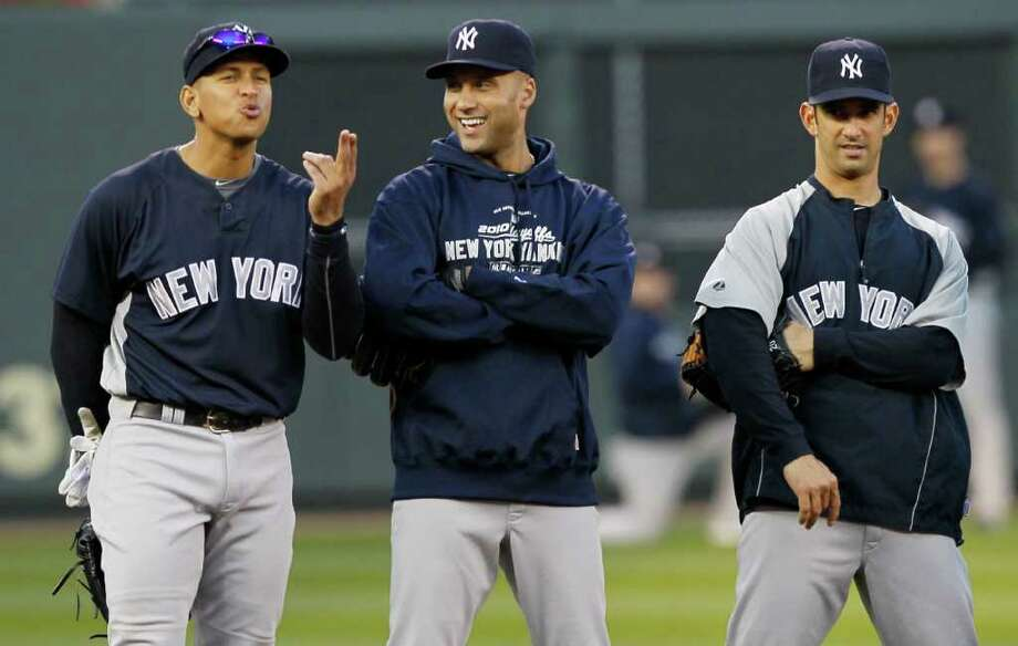 New York Yankees' Alex Rodriguez, left, Derek Jeter and Jorge Posada, right, have some fun during batting practice for baseball American League Division Series on Tuesday, Oct. 5, 2010, in Minneapolis. The Yankees are scheduled to play the Minnesota Twins in Game 1 on Wednesday. (AP Photo/Charlie Neibergall) Photo: AP
