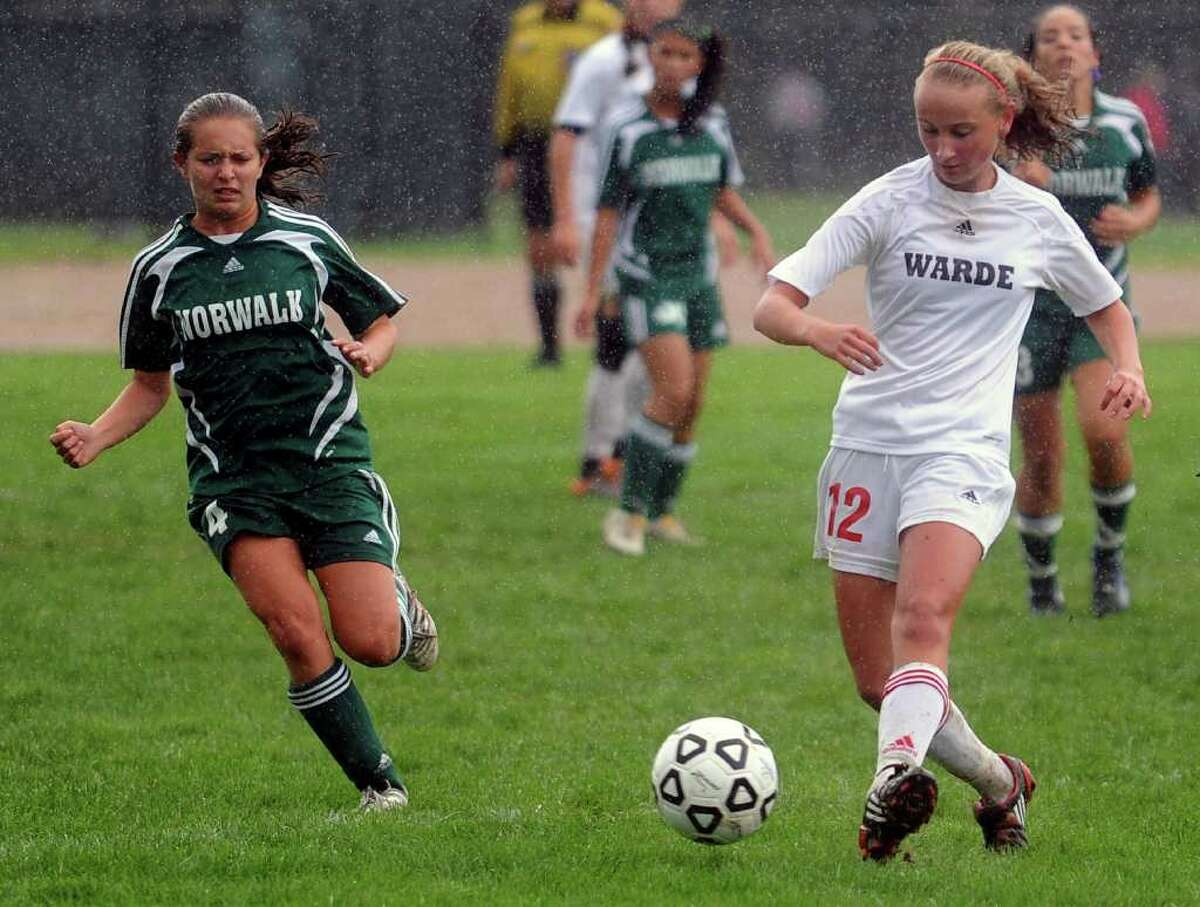 Fairfield Warde's Maggie Allen dribbles the ball away from Norwalk's Emily Pullen during Tuesday's game at Fairfield Warde High School on October 5, 2010.