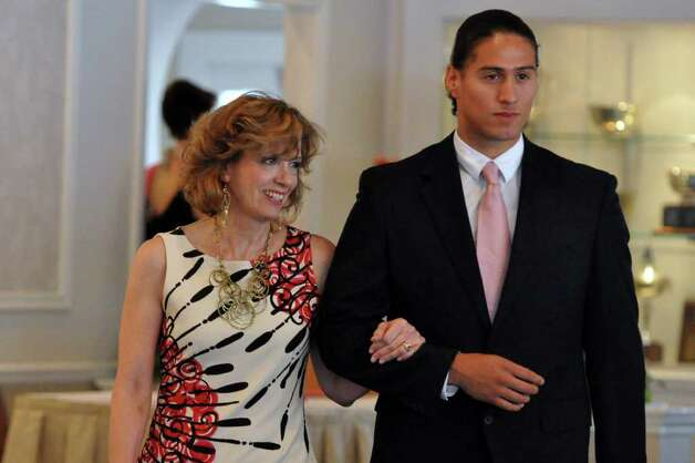 Denise Cesareo, of Redding is escorted by Javier Ceja, of Norwalk, during the 11th annual Breast Cancer Curvival Center's Celebrate Life Fashion Show at the Shore and Country Club in Norwalk on Sunday, Oct. 3, 2010. Photo: Amy Mortensen / Connecticut Post Freelance
