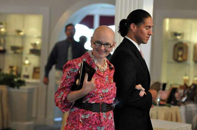 Fenella Pearson, of Norwalk, escorted by Javier Ceja, of Norwalk, during the 11th annual Breast Cancer Curvival Center's Celebrate Life Fashion Show at the Shore and Country Club in Norwalk on Sunday, Oct. 3, 2010. Photo: Amy Mortensen / Connecticut Post Freelance