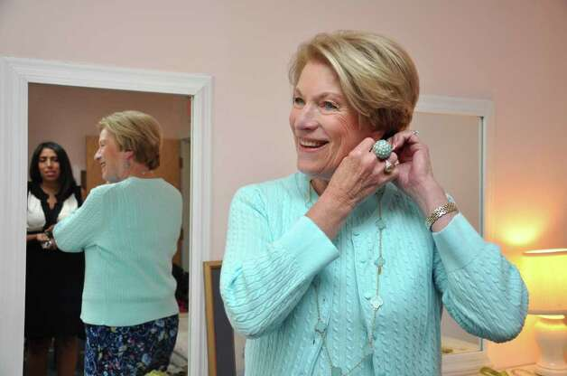 Karen Smith, of Norwalk, fixes her earrings moments before the 11th annual Breast Cancer Curvival Center's Celebrate Life Fashion Show at the Shore and Country Club in Norwalk on Sunday, Oct. 3, 2010. Photo: Amy Mortensen / Connecticut Post Freelance