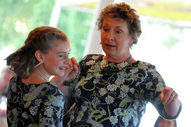 Rebecca Boyle, of Fairfield, shares a moment with her daughter, Leah, 11, during the 11th annual Breast Cancer Curvival Center's Celebrate Life Fashion Show at the Shore and Country Club in Norwalk on Sunday, Oct. 3, 2010. Photo: Amy Mortensen / Connecticut Post Freelance