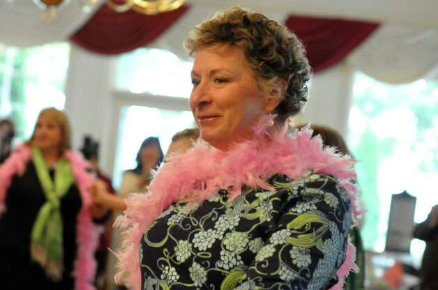 Rebecca Boyle, of Fairfield, dons a pink feather boa during the 11th annual Breast Cancer Curvival Center's Celebrate Life Fashion Show at the Shore and Country Club in Norwalk on Sunday, Oct. 3, 2010. Photo: Amy Mortensen / Connecticut Post Freelance