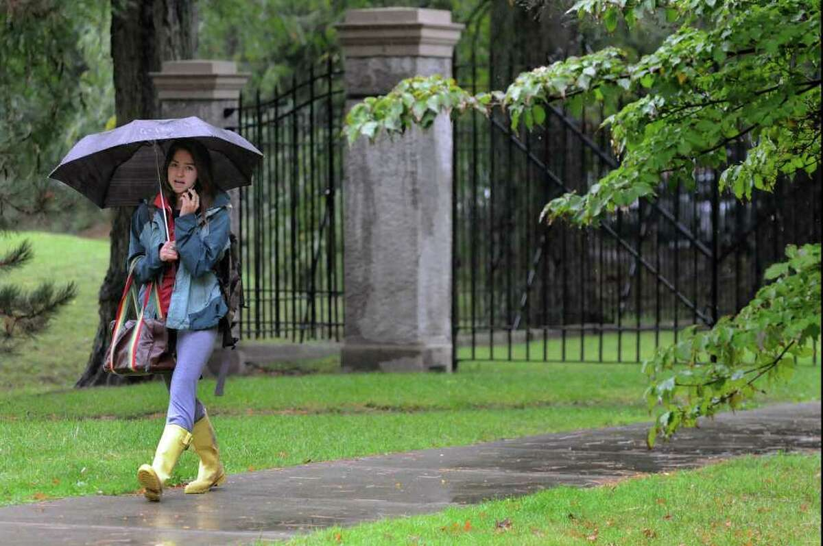 College student Kayla Horibe wears her rain gear on Wednesday, Oct. 6, 2010, at Union College in Schenectady, N.Y. (Cindy Schultz / Times Union)
